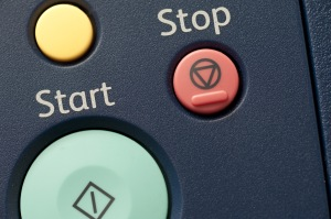 Start, stop, and cancel buttons on an office laser printer